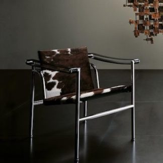 LC1LC1 - armchair - black enamel frame - seat and back in hairyskin with black leather arm straps